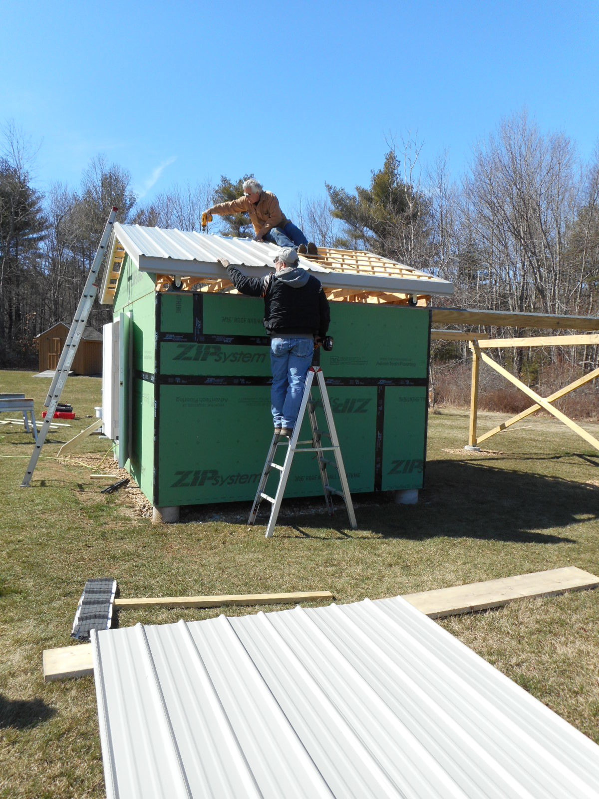 Kevin Boucher installs the roof panels