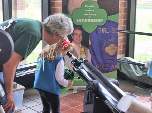 Kevin Boucher lets a young scout gain hands on experience with a telescope